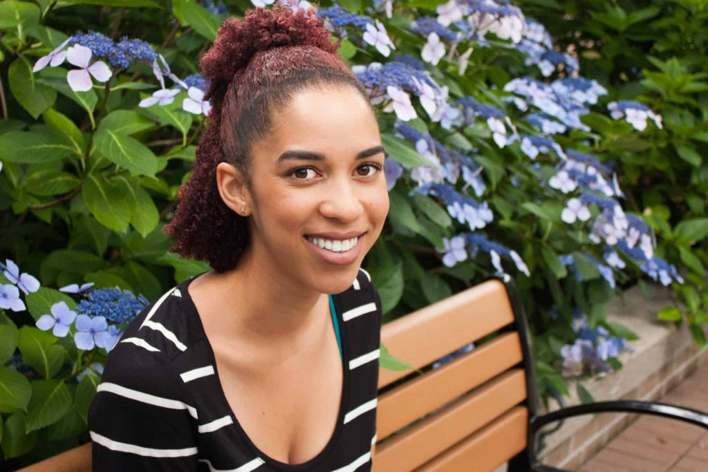 Woman with Dyed Red Natural Hair Smiling| Black Canadian | Natural Hair Blogger Type 3C/ 4A curls