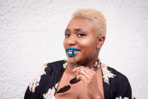 Short Blonde TWA with Blue Lipstick