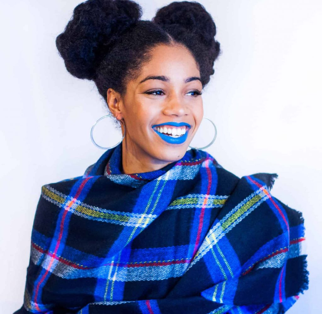 Black girl with Natural Hair Styled in two top buns with Blue lips Mac Cosmetics Blue Bang on Brown skin Bold lip colours