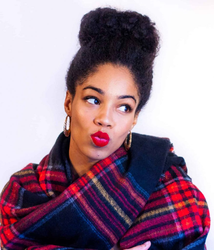 Black Model with Natural Hair in a top bun | Red Lips on dark skin with red plaid zara scarf Puckered lips