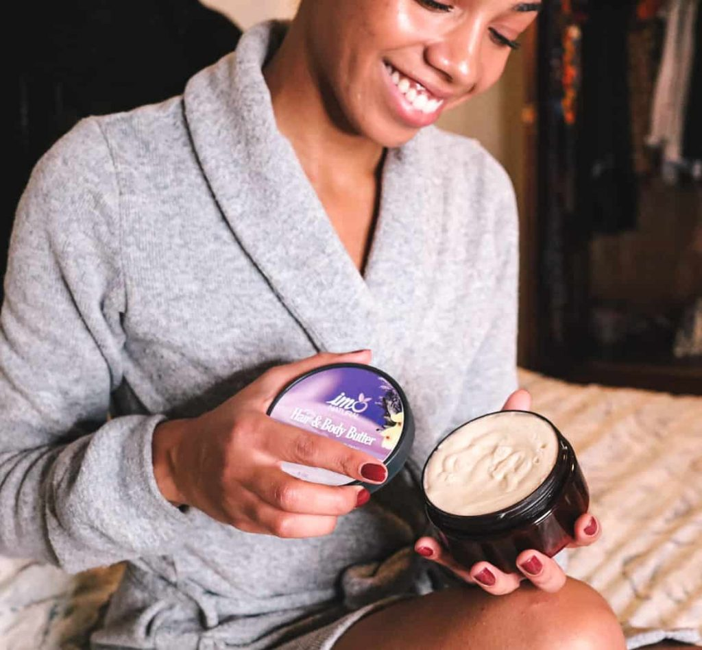 Black Canadian Blogger opening jar of IMONatural Hair & Body Butter in Lavender