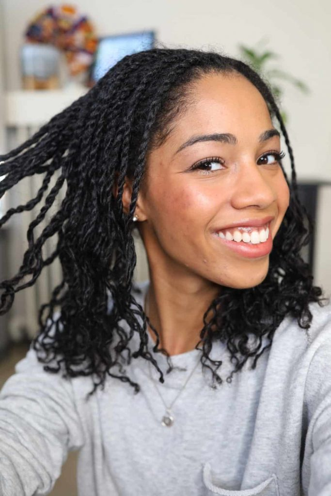 Natural Hair Blogger showing length of mini twists prior to styling