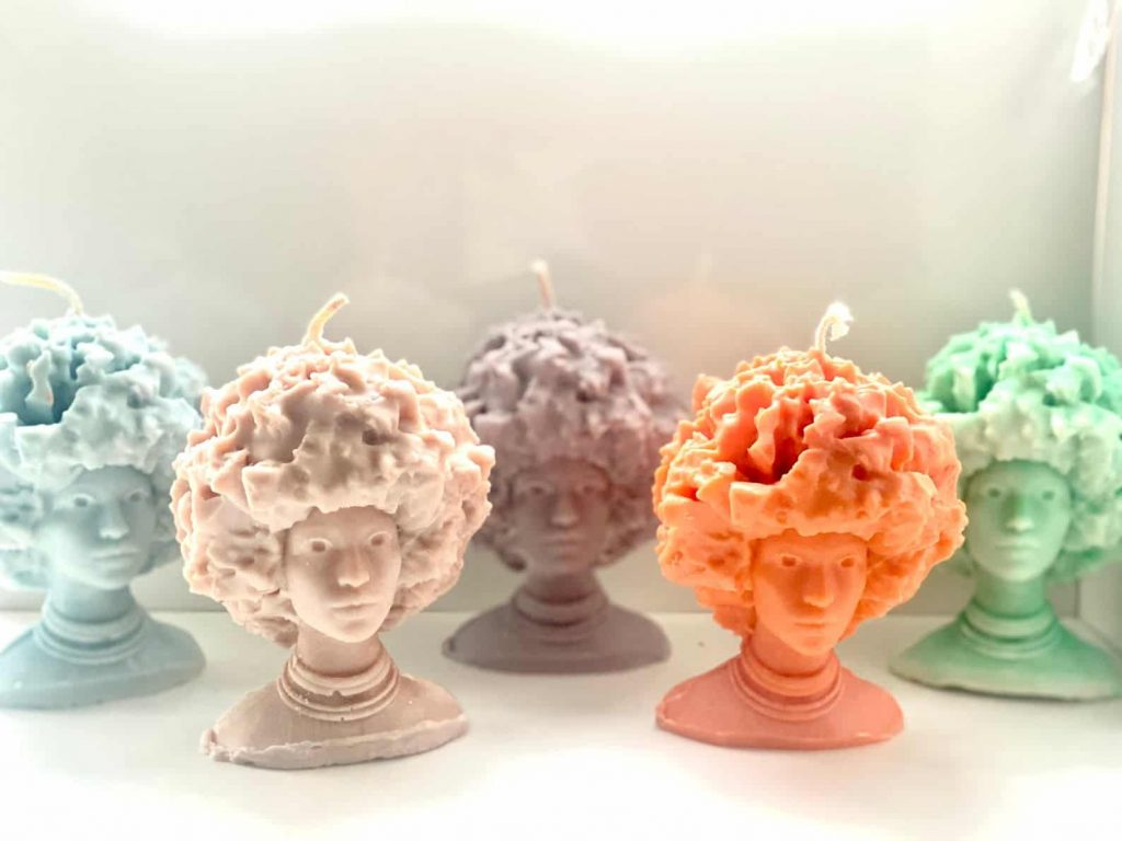 Black Owned Candles in the shape of a woman with Afro by O'Chan Made