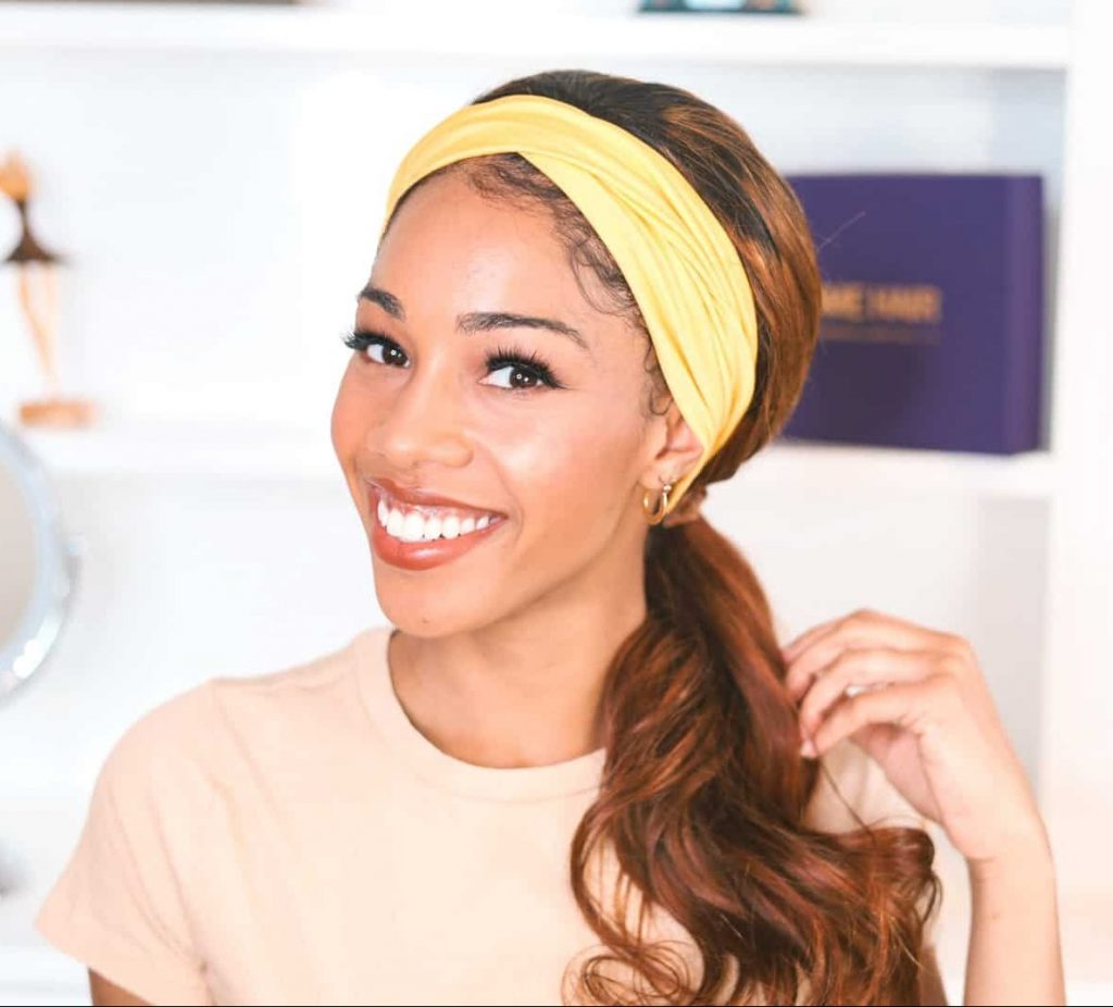 Hair piece with yellow head band styled in low ponytail