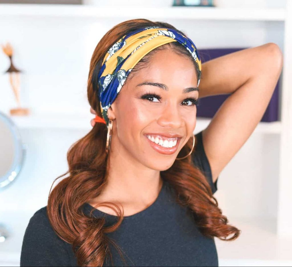 Loose Wave Luvme headband wig styled in low pigtails with yellow and blue headband