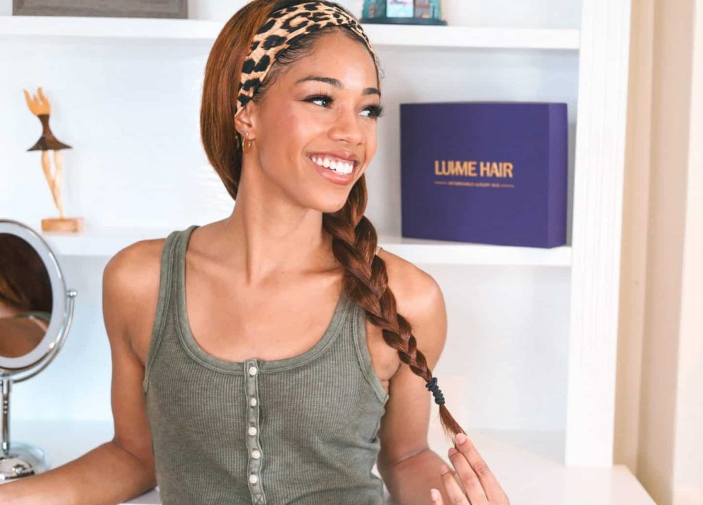 Styles for Luv Me Headband Wig. Animal Print headband with hair styled in side braid.
